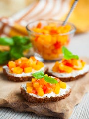 Toast with pumpkin chutney, a unique relish that provides extra pleasure at holiday meals.