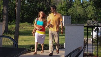"""Jill Duggar and Derick Dillard in a scene from TLC's """"19 Kids and Counting."""""""
