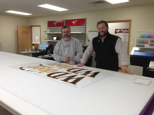Tyler Tamisiea, right, has opened Signarama in Ankeny. He is pictured here with Bruce Purdy, the company's production manager.