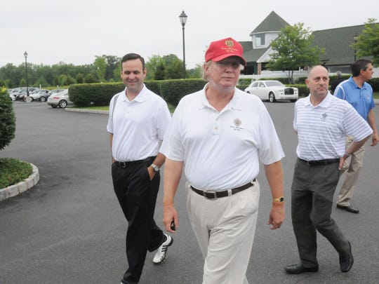 Donald Trump speaks with his managers during a June, 13, 2010 visit to Trump National Golf Club, Hudson Valley, in Stormville. Dan Scavino is on the left, and Andy Lavine is on the right.