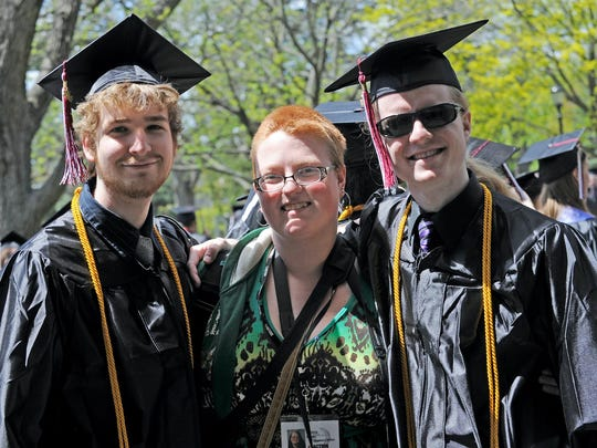 A few months after I shaved my head, a woman I interviewed asked me if I was proud that my sons graduated college, referring to this photo I had posted on social media. They are two years younger than me.