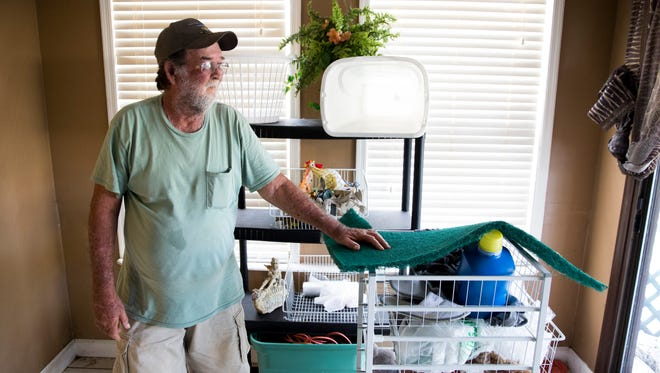 """Jack Guffey glances out his back window as he assesses the damage to his home along Chapman Avenue after the floodwaters had receded Thursday, Aug. 31, 2017, in Bonita Springs. Guffey and his wife, Virginia, originally from Immokalee, have lived in the house for four years but never purchased flood insurance. """"They wanted $1,800 a year. Three to four years and you can just repair stuff on your own,"""" Guffey said. """"You just dry up what you can and start all over."""""""