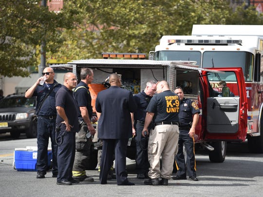 First responders are seen outside of the Center for