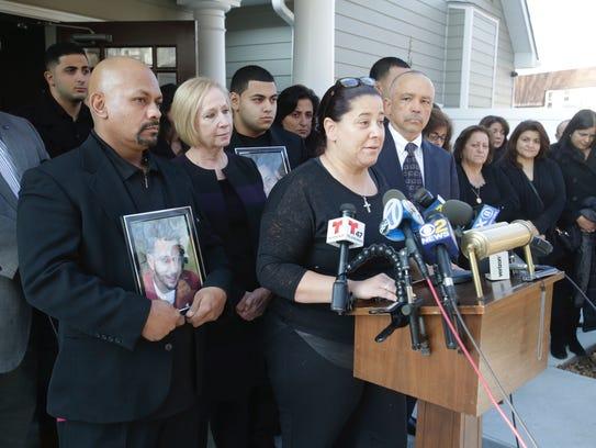 Nancy Maldonado-Khader speaks to the media outside