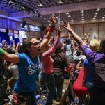 In a Saturday, May 14, 2016 photo, supporters of Democratic presidential candidate Bernie Sanders react during the Nevada State Democratic Party's 2016 State Convention at the Paris hotel-casino in Las Vegas.