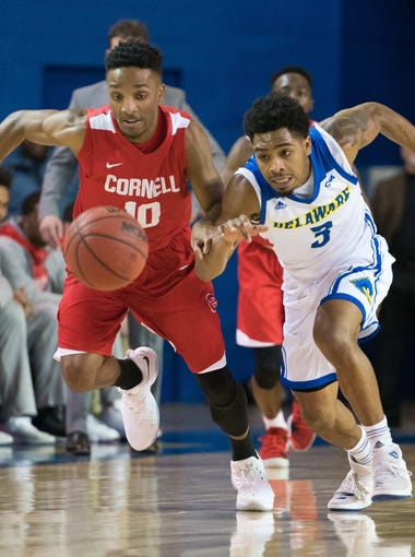 Delaware guard Anthony Mosley almost steals the ball from Cornell guard Matt Morgan as the Blue Hens make a come back late in the game.