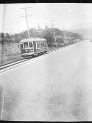 A trolley climbs the hill from the French Broad River