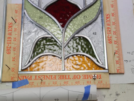 Stained glass windows are formed in the workspace of