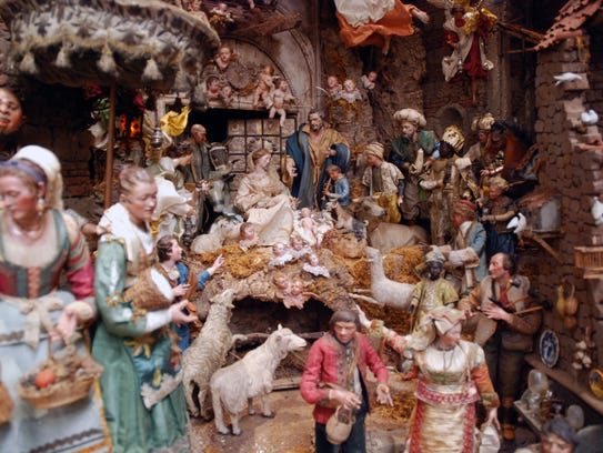 Surrounding the manger scene, there's a whole village