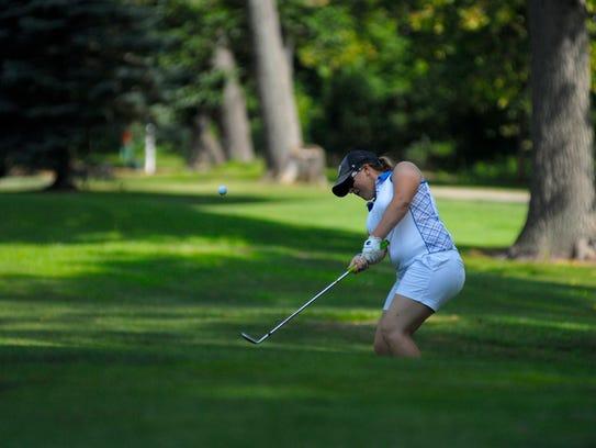 Kara Likins chips onto the green Monday, Aug 1, during