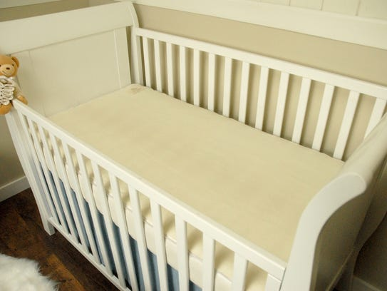 With the exception of the teddy bear, this crib meets