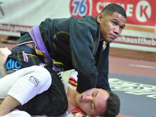 Isaac Balajadia, top, works a choke against his opponent at the 2017 Marianas Open at the Phoenix Center.