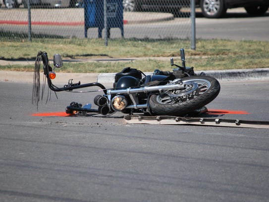 A motorcycle lays on its side after a collision at