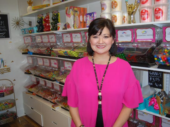 Owner Bridgett Karlson stands amidst the broad selection