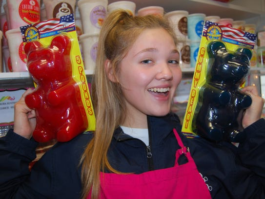 Groovy Gumball employee Lily Karlson has a bear on