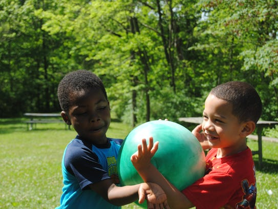 Students work together to pass the ball in a teamwork