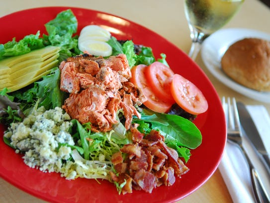 The salmon cobb salad at Cafe 1505 includes wild salmon and a house-made lemon dijon dressing.