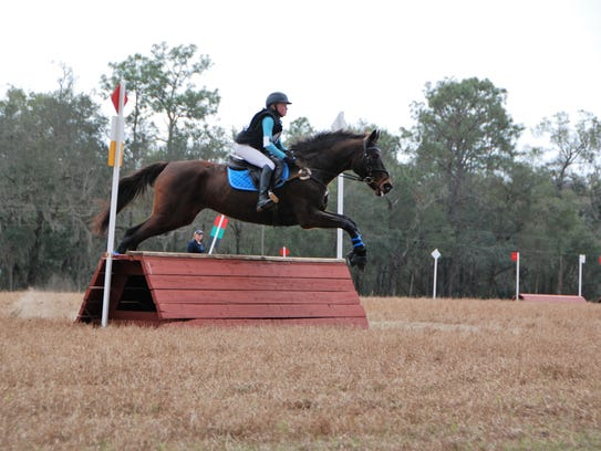 Caroline Holmes, riding Dignitarian, soars over the