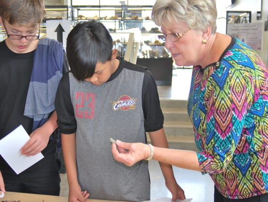 Alicia Blasingame shows Kirtland Middle School eighth-graders