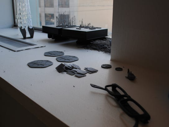 Pieces created on 3D printers are seen Thursday at