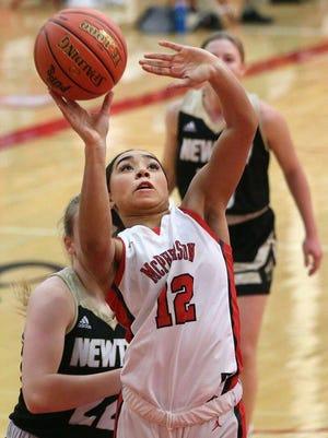McPherson's Peyton Howard (12) shoots the basketball during their game against Newton Tuesday night. McPherson defeated Newton 59-20.
