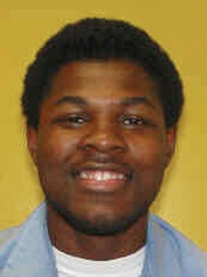 This undated photo provided by the Ohio Department of Rehabilitation and Correction shows Brandon Moore. Moore was tried as an adult and convicted by a jury in the 2001 armed kidnapping, robbery and gang rape of a 22-year-old Youngstown State University student. Lawyers for Moore, a convicted rapist who claims a 112-year prison sentence imposed when he was 15 years old violates his constitutional rights want the Ohio Supreme Court to overturn the sentence. (AP Photo/Ohio Department of Rehabilitation and Correction)