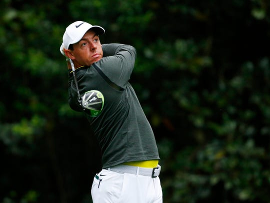 Rory McIlroy hits a tee shot on the 11th hole during