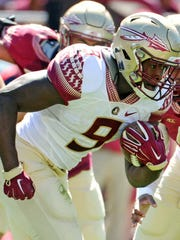 Florida State Seminoles running back Jacques Patrick (9) runs the ball during the Spring Game at Doak Campbell Stadium.