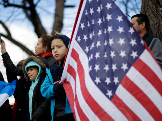 """Demonstrators gather in Baltimore on Feb. 16 as part of a nationwide protest, called """"A Day Without Immigrants."""""""