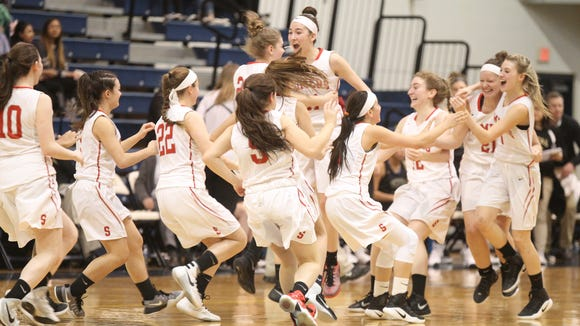 Somers celebrates their 44-39 win over Vestal in the girls NYSPHSAA Class A regional final at Pace University's Goldstein Center in Pleasantville on Saturday, March 11, 2017.