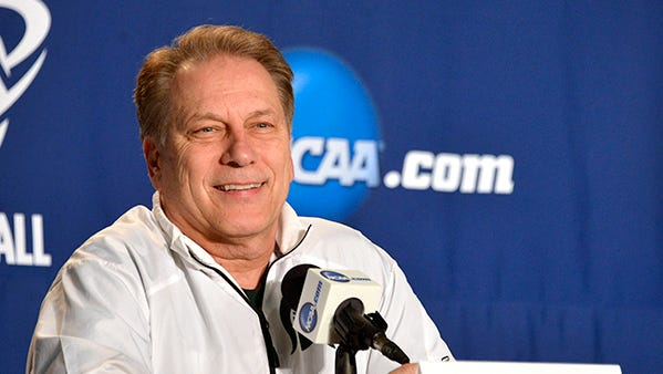 Tom Izzo grins as he takes his place during the official NCAA player and coach interviews Saturday afternoon in Charlotte, N.C.