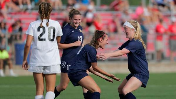 Sheboygan North High School's McKayla Kertscher, right, celebrates scoring her second goal with teammates Maggie Mueller (13) and Alivia Hundt (10) during the second half against Muskego High School during their WIAA Division 1 Semifinal girls state soccer game Thursday, June 14, 2018, at Uihlein Soccer Park in Milwaukee, Wis.