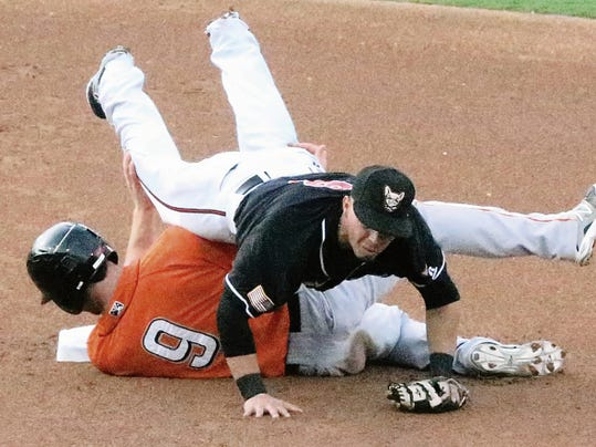 Rudy Gutierrez—El Paso Times El Paso Chihuahuas short stop Benji Gonzalez falls over Fresno Grizzlies base runner Nolan Fontana, 9, after throwing to first base in a double play attempt Tuesday night at Southwest University Park.
