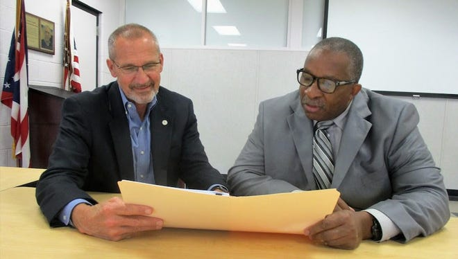 Scott McKenzie and Stan Jefferson review plans for a detailed assessment of Mansfield City Schools facilities.