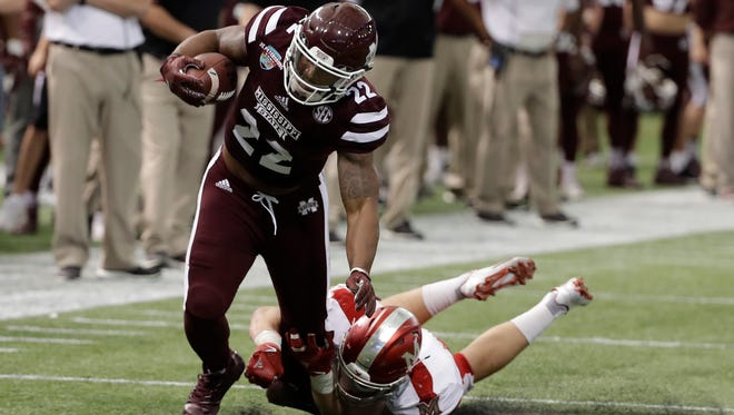 Mississippi State wide receiver Malik Dear (22) is stopped by Miami (Ohio) linebacker Brad Koenig during the second half of the St. Petersburg Bowl NCAA college football game Monday, Dec. 26, 2016, in St. Petersburg, Fla. Mississippi State won the game 17-16. (AP Photo/Chris O'Meara)