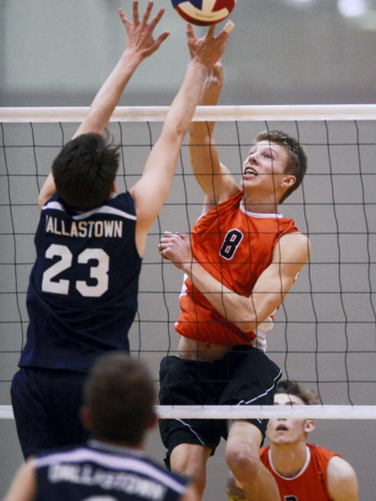 Central York's Nate Mehl hits against Dallastown's Peyton Ranck during Tuesday's boys' volleyball match at Central York. Central York swept Dallastown, 3-0.