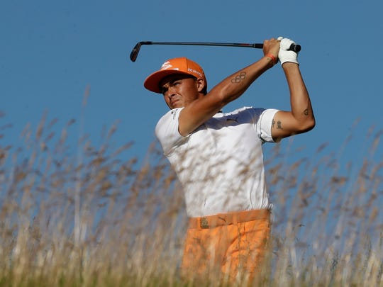 Rickie Fowler hits a drive during the fourth round of the U.S. Open golf tournament Sunday, June 18, 2017, at Erin Hills in Erin, Wis. (AP Photo/Charlie Riedel)