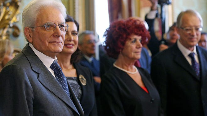 From left, newly elected Italian President Sergio Mattarella, Italian Camera president Laura Boldrini, and Italian vice president of the Senate Valeria Fedeli appear at Constitutional Court in Rome, Italy, on Jan. 31, 2015/