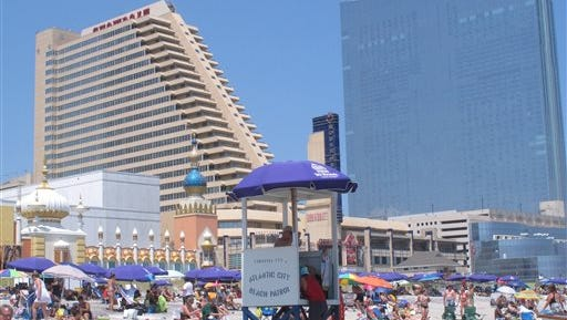 This July 23, 2014 photo shows the Showboat Casino Hotel, left, and Revel Casino Hotel, right, a few weeks before both shut down. After the worst year in the 36-year history of casino gambling in Atlantic City, which saw four of its 12 casinos close, the battered industry bids good riddance to 2014 and hopes for a better roll of the dice in 2015.