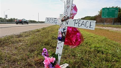 A memorial has been set up in honor of the late Phoebe Jonchuck, 5, on the south side of the Dick Misener Bridge near the north end toll booths of the Sunshine Skyway Bridge, St. Petersburg. The girl was thrown from the top of the Misener Bridge by her father John Jonchuck Jr. The view is looking southbound.