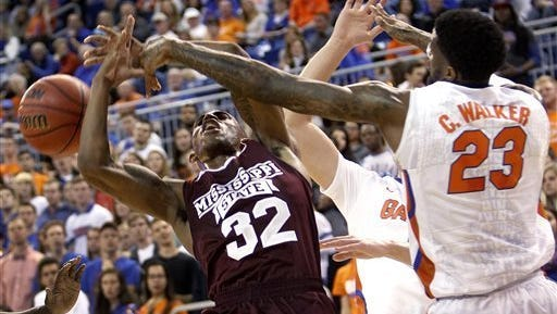 Mississippi State guard Craig Sword has his shot blocked against Florida.