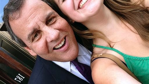 In this July 2, 2015 photo provided by Emma Nozell, Republican presidential hopeful Chris Christie poses for a photo with Emma Nozell in Nashua, N.H. Nozell and her sister, Addy Nozell, of Merrimack, N.H., are attempting to take photos with every presidential candidate campaigning in the state. They came up with the idea after Emma took this picture with Christie.