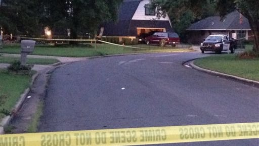 Crime scene tape marks off the area as police investigate scene, Thursday morning, July 23, 2015, in Broken Arrow, Okla., where authorities say five people were found dead late Wednesday night. Police say a 16-year-old and an 18-year-old, who are both related to the victims, were taken into custody. (AP Photo/Justin Juozapavicius