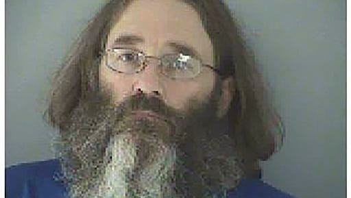"""This undated photo made available by the Butler County Jail shows James Hammes. Arrested by federal agents in May 2015 at Damascus, Va., near the Appalachian Trail, Hammes is facing federal trial in Cincinnati in October for embezzlement. He had been a fugitive for six years, hiking under the name """"Bismarck."""""""