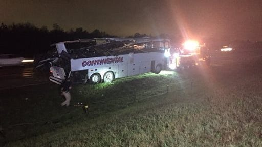 This photo provided by KTHV in Little Rock shows a charter bus being towed away after it ran off Interstate 40 and hit a bridge abutment on Friday, in North Little Rock, Ark.