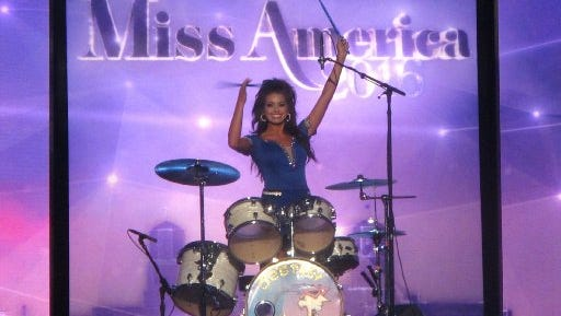 Miss Puerto Rico Destiny Noelle Velez plays the drums during the third night of preliminary competition in the 2016 Miss America pageant in Atlantic City, N.J. on Thursday, Sept. 10, 2015.