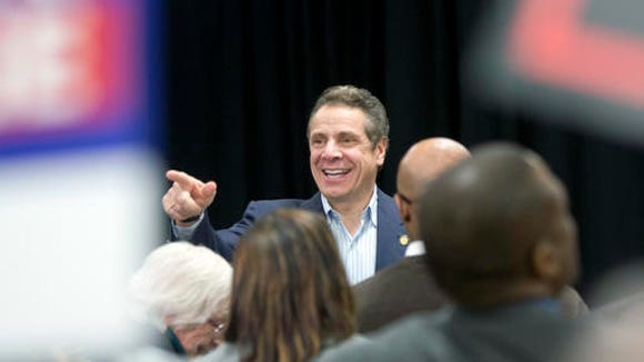 New York Gov. Andrew Cuomo arrives to a rally to raise the minimum wage on Thursday, Feb. 25, 2016, in Albany, N.Y.