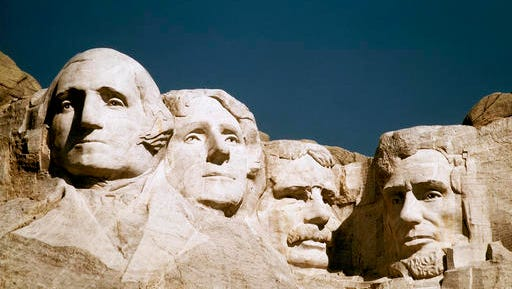 In this undated file photo, Mount Rushmore is shown in South Dakota. From left are George Washington, Thomas Jefferson, Teddy Roosevelt and Abraham Lincoln. The Partners in Preservation Campaign is asking the public to vote on 20 historic sites, including one at Mount Rushmore, that are vying for $2 million in preservation funding. The project at Mount Rushmore seeks $250,000 to restore structural elements of the Borglum View Terrace, where Rushmore sculptor Gutzon Borglum's original studio stood.