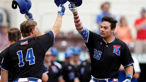 Louisiana Tech's Cody Daigle (25) Jonathan Washam (14) are two of several returning players back for 2017. The baseball team has their first practice of the year Friday.
