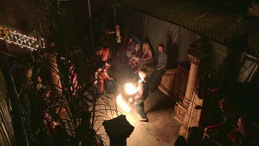 This Nov. 1, 2016 photo provided by David Coons shows a fire dance performance in an underground music club known as known as Purple 33 in a Playa Vista neighborhood of Los Angeles. About a week after 36 people died in a fire at an underground music party in Oakland, inspectors acting on a complaint discovered a makeshift nightclub and unpermitted living quarters concealed in a warehouse near Los Angeles International Airport. Authorities searching the drab, two-story building found an illegally constructed dance floor, paired with a bar and DJ booth.